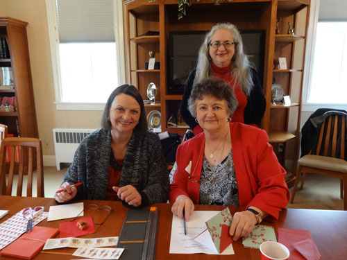 Valentine's Day Cards to Veterans Writing Valentine cards to veterans, front left Sue Dahlin, Judith Finney, and Shea Huey (back).